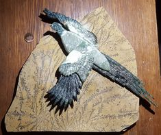 Pheasant is different kinds & colors of Jade. The background slab is Dendritic Sandstone or Slate, where the fern-like patterns (dendrites) occur naturally. Zoom in to see details of feathering. Bird is x