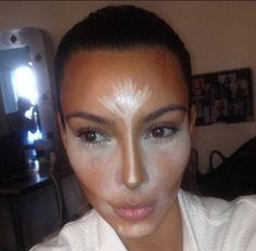 The white undereye brightens the face and highlights the cheekbones, while the shimmer going up the nose and forehead slims the nose and wakes up the face. Kim K's make up artist's tricks.