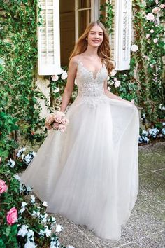 Venice lace adorns this illusion bodice wedding dress. Soft English net and tulle make movement a breeze. Spaghetti straps connect the back illusion panel of the bodice with button closures. Bodice Wedding Dress, Wedding Dress Necklines, Top Wedding Dresses, Affordable Wedding Dresses, Wedding Gowns, Bridal Gowns, Belle Bridal, Bridal Lace, Corsage