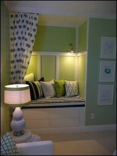 Playroom Reading Nook - love the paneling lighting, and storage in the bench.