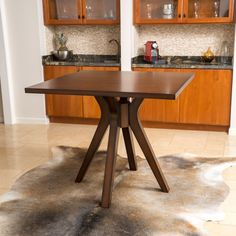 The Tehama square wood dining table gives your home a cozy feel. Featuring a sturdy construction and natural wood blend, this table is ideally suited for the traditional home dining setting.