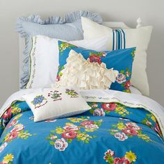 Petit chateau bedding via Land of Nod - love the vintage floral pattern