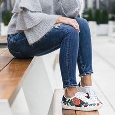 Casual fall look. Grey ruffle sleeve sweater with skinny denim and Gucci statement sneakers.