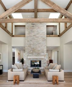 Great room, living room - Modern rustic farmhouse Swiss Coffee by Benjamin Moore paint. Rustic white oak wood floors with a whitewash finish. Stone faced fireplace: