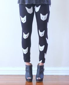 Super+cute+black+leggings+with+ivory+kitty+kat+graphic+prints+all+over!+Elastic+waist.+    Measurements+from+a+Size+SMALL  (Add+1+inch+for+each+size+up)  Waist:+24+inches+(ELASTIC+WAIST)  Length:+37.5+inches    Cotton/Lycra/Spandex+Blend  Made+in+USA