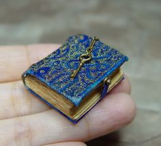 """Handmade 1"""" to 1' Fantasy Dollhouse Miniatures. Including Leather Bound Books, Wands, Hourglasses, Potions, Celestial Instruments, and other miniatures for your witch and wizard."""