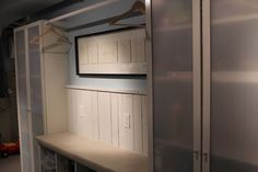 Two ikea shelving units with closet rod in-between for laundry room area in basement. Underneath are more shelves for storage.  Very interesting and practical.