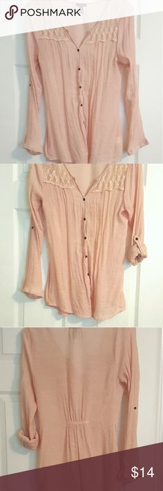 Light pink button up top Light pink, lace details on chest, button up top that can be worn long or 3/4 sleeve... semi sheer fabric-last photo is my hand behind it... has belt loops of you want to wear a belt (not included)...EUC. Tops Blouses