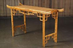 Vintage Faux Bamboo and Rattan Top Console with Chinese Fretwork and Styling. Sarasota, FL, Circa 1970s