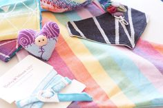 Wrap scrap goodies make our hearts pitter patter Baby Wearing, Goodies, Scrap, Hearts, Gift Wrapping, Rainbow, How To Make, Gifts, Sweet Like Candy