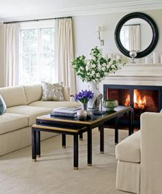 "Cool gray-and-white color scheme soothes, while warm gold, chocolate brown, & mossy green accents add warmth.  Sofas (""Porter Sofa"" #BB038-01): Barbara Barry Realized by Henredon, barbarabarryco.com. Coffee table: Pride Sasser Home Furnishings, 828/437-1991 trade only. Available through Michael Folks Showroom Sconces (""Haberdasher Sconce''): Visual Comfort & Co., trade only. Mirror (""Magni Mirror,'' 36"" diam #9116): Nancy Corzine, nancycorzine.com. Rug (hand-woven Tibetan wool): Ramri Rug,"