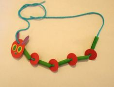 The Very Hungry Caterpillar Necklace on hands on : as we grow