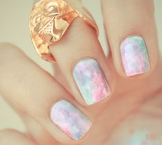 Watercolor nails- Paint nails white. Then put colors of your choice spread out on your nail, then smear with a plastic baggy & add a top coat to get this effect.