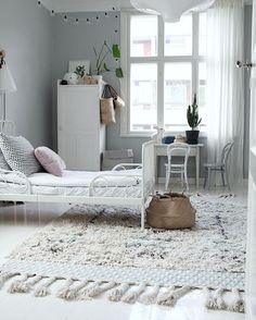 All white Kids room with the lightest grey walls