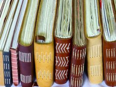 handmade leather journals with exposed stitching