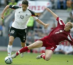 Latvia 0 Germany 0 in 2004 in Porto. Igor Stepanovs puts in a good tackle on Kevin Kuranyi in Group D at Euro 2004.