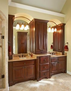 Traditional Bathroom : Cherry Cabinets, Footed Cabinets, Vaulted Ceiling, Double Sinks, Jewelry Cabinet, Wall Lighting