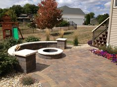 Fire pit patio by Bellas Landscaping