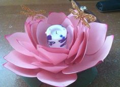 This is made with the Giant Flower cart with cricut.... Very lifelike.. Can be made any color and would make great centerpieces with battery teal lite...