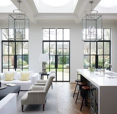 modern neutral living room design and kitchen design Symmetry + insanely good architectural details (hello doors!) make us weak in the knees. In the case of this gorgeous space by… Family Room Design, Dining Room Design, Kitchen Design, Kitchen Ideas, Family Rooms, Dining Area, Dining Table, Home Interior Design, Interior Architecture