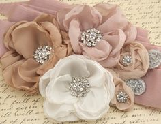 Bridal Sash Sash in Blush Pink, Dusty Rose, Nude, Champagne and Ivory with Crystals- Magnolias in Bloom. $250.00, via Etsy.