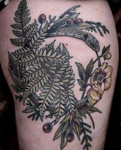 Floral Ouroboros tattoo