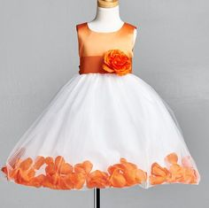 Top Solid Dress By Little Girls Wardrobe<3  This listing includes  One top solid Dress One matching sash and flower (Easily Detachable)