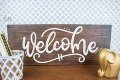We love celebrating Freebie Friday. This download is a free hand lettered Welcome cutting file that is perfect for making wood welcome signs.