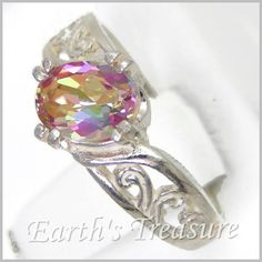 This Sterling Silver Ring has Victorian Filigree detailing. The Mystic fire topaz is set in a unique Mystic Fire Topaz, Jewlery, Jewelry Necklaces, Topaz Ring, Filigree, Diamond Rings, Mercury, Sterling Silver Rings, Heart Ring