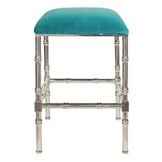 Nickel bamboo counter stool with turquoise velvet cushion.