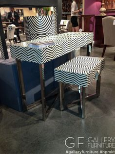 Everyone loves a chevron print. Check out these cool print console tables with chrome legs. #hpmkt #gfhpmkt #gftoday #2013 | Houston, TX | Gallery Furniture |