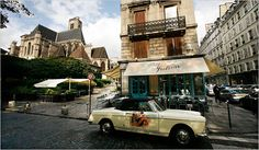 Paris: A vintage car parked in front of the restaurant Chez Julien. Photo: Ed Alcock for The New York Times