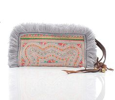 Panada Fringe Clutch from Histoire. It's made from vintage Hmong tribe costume and each piece is one-of-a-kind.