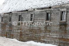 The side of a neglected barn in the bottom of a North Dakota slough.
