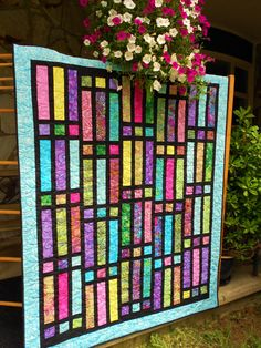 Gateway To Paradise Quilt -- jelly roll quilt with black sashing like stained glass (patter available)