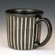 Wheel Thrown Mugs by Larry Halvorsen. Wheel thrown stoneware mugs with black glaze and sgraffito carving. The mugs are dishwasher and microwave safe. Each mug holds 12 oz. Stoneware Mugs, Ceramic Cups, Earthenware, Pottery Mugs, Pottery Bowls, Pottery Supplies, Clay Cup, Wheel Thrown Pottery, Egg Holder