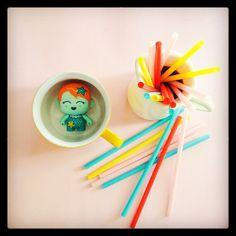 #redo #7vignettes challenge:  NEW.  A few new things from our Melbourne holiday. White jug and plastic straws from IKEA, yellow hot chocolate mug from Officeworks and Aqua Spikey from Smiggle.