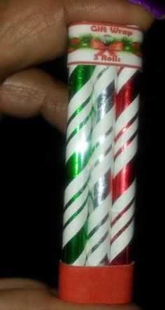 Miniature Christmas gift wrap. Rolls made from straws, packaging made from packaging from real-life stickers. I cut it to size and taped it neatly in back with a skinny piece of packaging tape. Printie designed and made by me.