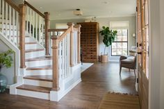 """One of the first things you notice when walking into this home is the staircase. It was previously very dated, but we opened it up and added this traditional railing to give a bigger """"wow"""" when you walk through the door."""