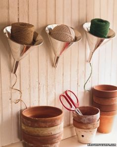 I love the funnel organization for twine! Could work well for ribbon too! - Martha Stewart Rubber-Coated Hook Hangers Make the most of the space you have, including the wall. In this one-car garage, rubber-coated hooks hold a coiled hose and ladder; bungee cords stretched between studs create even more storage. A shovel is kept on a wall shelf. Another idea: Hang bikes by their frames on ladder hooks on the wall, and use the space behind the door for storing flat items, such as folding…