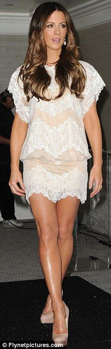 Gorgeous lace dress.  Wonder if my legs would look that good. lol