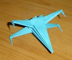 Want to make a string of rainbow colored X-Wings to bring a bit of Star Wars into my craft room!