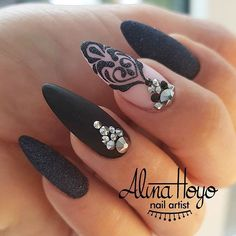 Oval shaped nails with black gel polish and matte top coat, black floral art with sugaring and rhinestones. Beautiful nails by @alinahoyonailartist Ugly Duckling Nails page is dedicated to promoting quality, inspirational nails. Tag us and mention what Ugly Duckling products you used for a chance to be featured #nailartaddict #nail