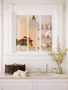 if your kitchen borders another living area or hall, install an interior window in the wall to make it more interesting; recycle a window or stained glass to let in some light