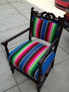Refinished Frame and Reupholstered in Serapes.