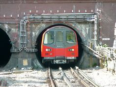 "This is a north-bound Northern Line tube train emerging from the deep level tube tunnel at Golders Green.   I call this picture ""Only Just!"""