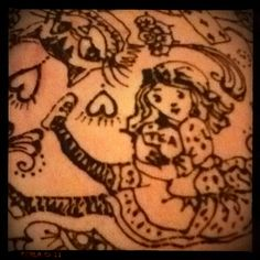 Alice in henna. On pregnant belly.