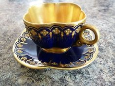 For sale I have an absolutely exquisite Coalport miniature cabinet cup & saucer decorated using the prestigious Jewelled technique. It is very delicate and is of quatrefoil form. It is decorated wit