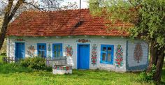 Zalipie, Poland. In that village, women paint flowers on everything! The houses, the bridges, the wells, inside houses, even the churches and the crosses! How mad