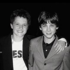 Its Josh Hucherson (Peeta Mellark) and Logan Lerman (Percy Jackson)  <3